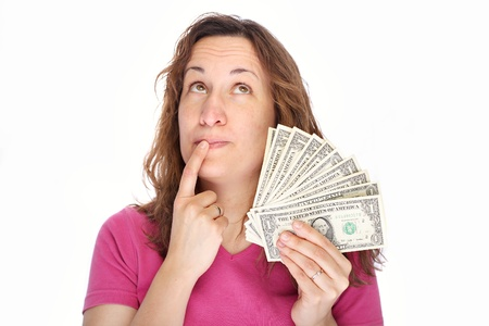 pensiveness: Young thoughtfully woman with money in hand