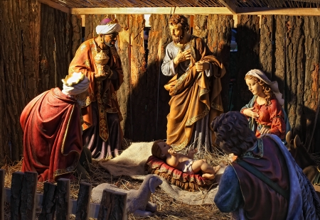 Creche scene in shelter with statues