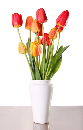 Bouquet from tulips in china vase isolated on white Stock Photo - 15577222