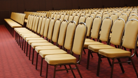 Empty chairs in conference hall photo