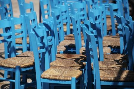 wickerwork: Blue wickerwork chairs in a pile