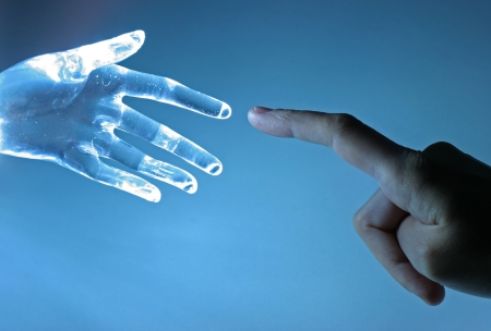 anonymity: Human hand and artificial hand touch each other