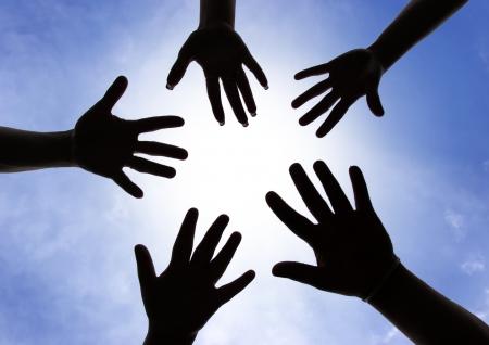 Hands symbol of union touch white light Foto de archivo