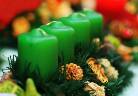 Four candle in row with colorful christmas decoration Stock Photo - 16496251