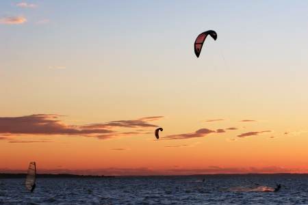 Wind and kite surf competition beautiful sky in background