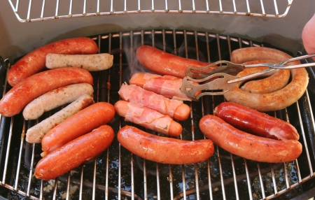 Sausages are grilled at the barbecue party photo