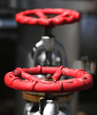 Gas pipe with two red valve photo