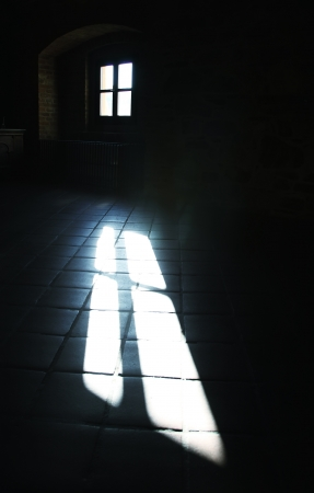 Sunlight through a window in a dark room photo