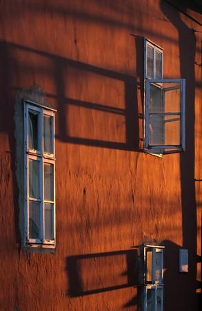 redish: Windows on an old redish wall