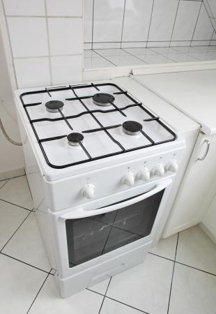 White gas cooker in white tiled kitchen photo