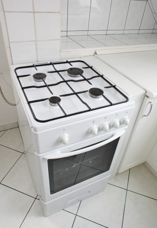 White gas cooker in white tiled kitchen Stock Photo - 16251928