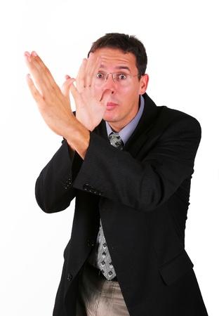 irrespeto: Business man mocking with his hand Foto de archivo