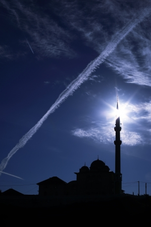 mohammedan: Silhouette of mosque with blue sky Stock Photo