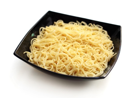 Boiled spaghetti pasta in black bowl Stock Photo - 17136838