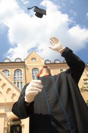 obtain: Throwing the mortar in happiness after graduation outdoor