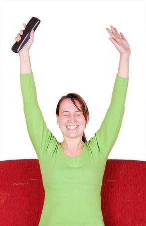red couch: Overjoyed young woman with remote-control on red couch
