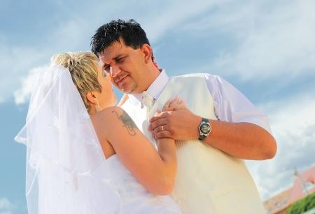 Young wedding couple dancing outdoor photo