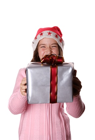 Beautiful christmas girl smiling and holding presents isolated on white photo