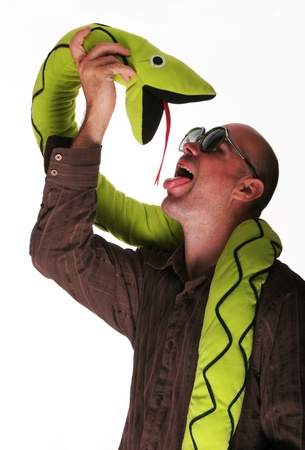 animal idiot: Crazy guy lick of the tongue toy snake Stock Photo
