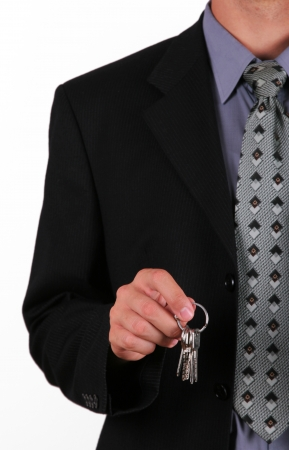 Business man hold key in his hand photo