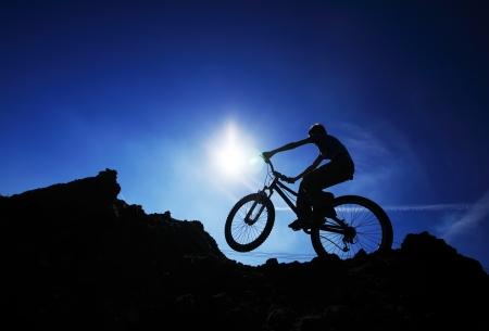 bmx bike: Cyclist silhouette on BMX bike Stock Photo