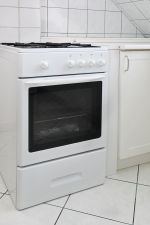White gas cooker in white tiled kitchen Stock Photo - 18007689