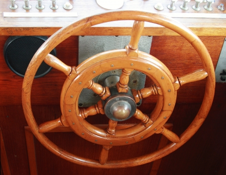 Wooden steering wheel sailboat inside photo