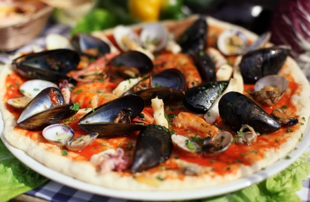 Seafood italian pizza with mussel photo