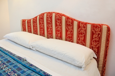 Red bed in a hotel room Stock Photo - 20623267