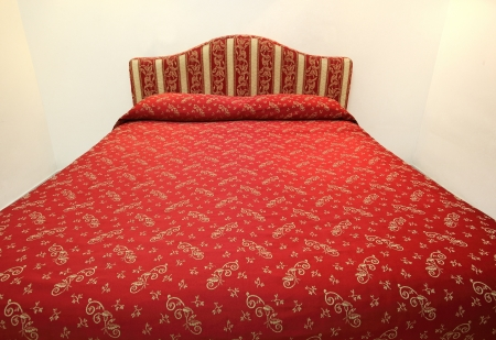 Red bed in a hotel room photo