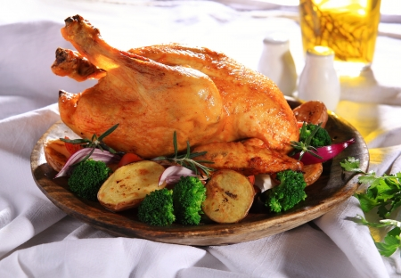 chicken leg: Roasted whole chicken on a plate with vegetables