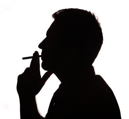 Man portrait smoking cigarette silhouette in studio isolated white background photo