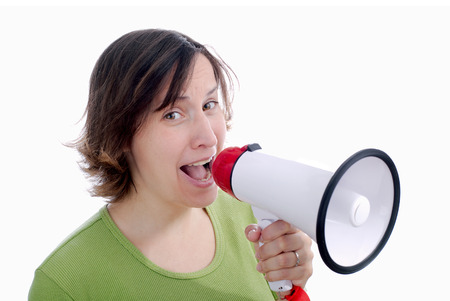 Woman speaking on a megaphone - isolated over white