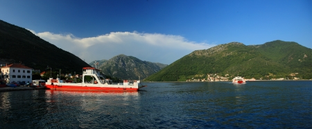 Kotor bay in Montenegro with ferry photo