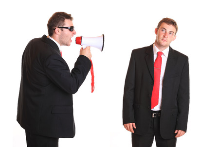harass: Business man getting a rough announcement Stock Photo