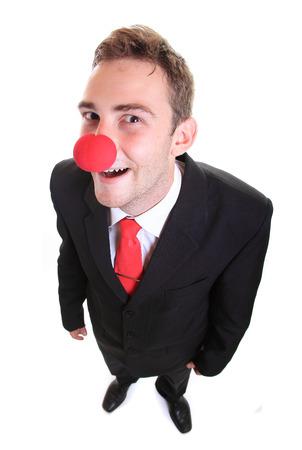 nez de clown: Homme d'affaires portant un nez de clown Banque d'images