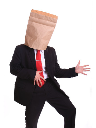 Businessman with a paper bag on head dancing Stock Photo - 27785157