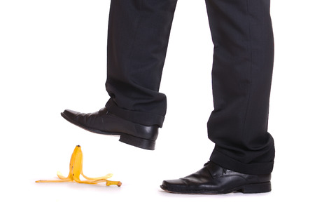 Man about to step on banana peel photo