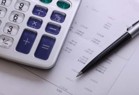 cash flow statement: Calculator bill and pen, business and financial issue