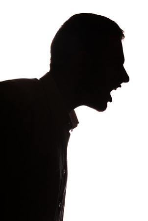 choleric: Man portrait silhouette profile screaming angry in studio isolated white background Stock Photo