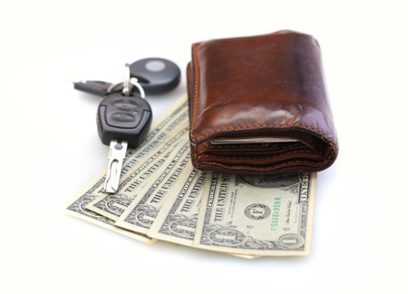 Car-key, wallet and money isolated on white photo