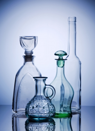 Four empty transparent bottle composition photo