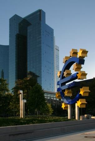 ecb: Euro symbol in Frankfurt among skyscrapers Stock Photo