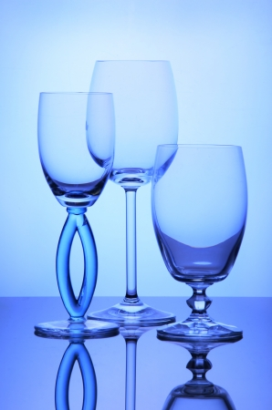 Three empty transparent wine glasses composition photo