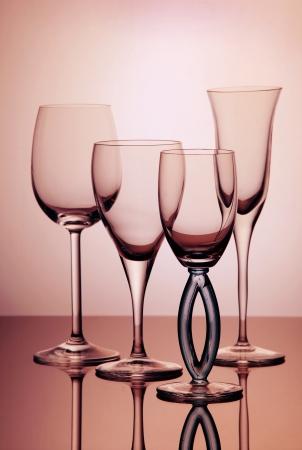 Four empty transparent wine glasses composition photo