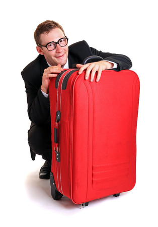 freaked: Funny business man hide behind red luggage