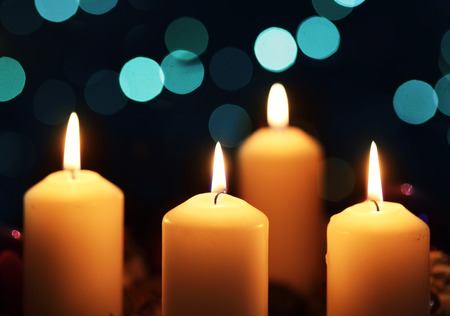 Four candles against abstract background photo