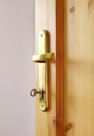 Detail of wooden door and door handle photo