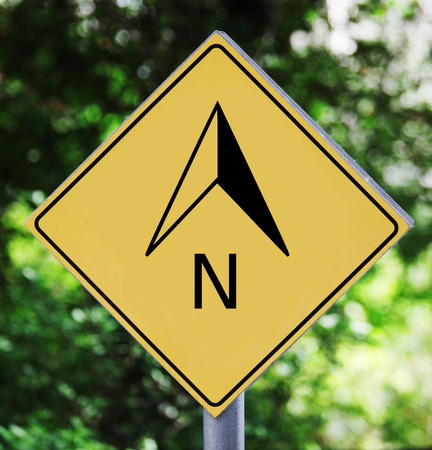 north arrow: Yellow traffic label with north arrow pictogram