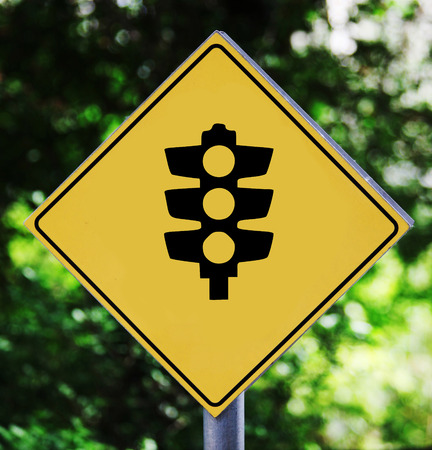 trafficlight: Yellow traffic label with trafficlight pictogram Stock Photo